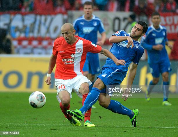 Elkin Soto of Mainz battles for the ball with Kevin Volland of Hoffenheim during the Bundesliga match between FSV Mainz 05 and TSG 1899 Hoffenheim at...