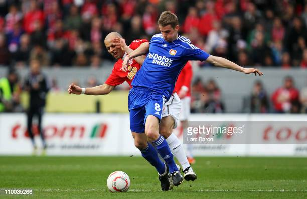 Elkin Soto of Mainz challenges Lars Bender of Leverkusen during the Bundesliga match between FSV Mainz 05 and Bayer Leverkusen at Bruchweg Stadium on...