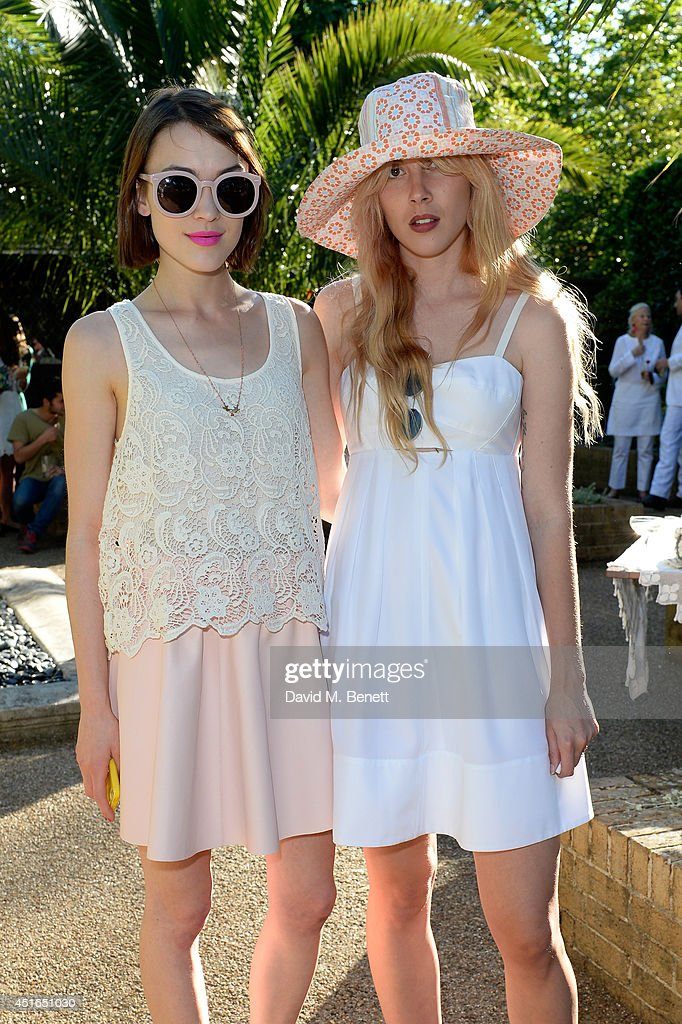 Ella Catliff (L) and Paula Goldstein attend the Club Monaco Garden Party hosted by Quentin Jones, Clara Paget and Annie Morris in Eaton Square on July 3, 2014 in London, England.