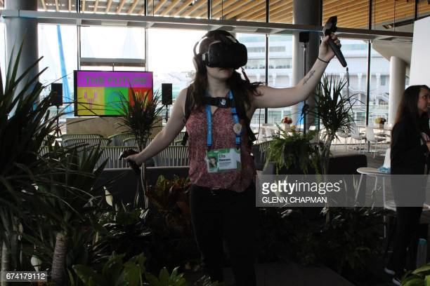 Ella Dawson experiences what it is like to be a tree in rain forest faced with destruction in a virtual reality presentation at a TED Conference in...