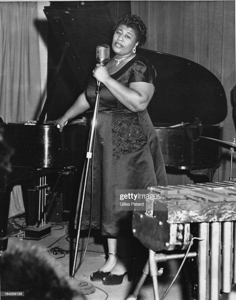 <a gi-track='captionPersonalityLinkClicked' href=/galleries/search?phrase=Ella+Fitzgerald&family=editorial&specificpeople=90780 ng-click='$event.stopPropagation()'>Ella Fitzgerald</a> performs on stage, USA, 1955.