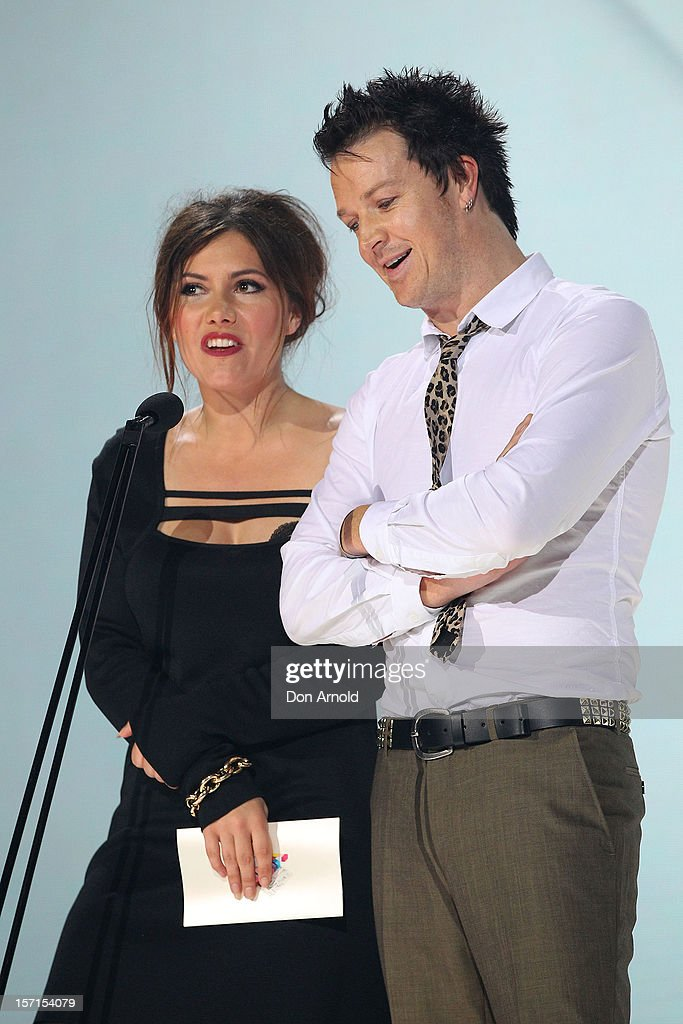 Ella Hooper and Chris Cheney present the ARIA for best Rock release on stage at the 26th Annual ARIA Awards 2012 at the Sydney Entertainment Centre on November 29, 2012 in Sydney, Australia.