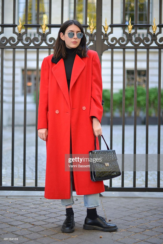 Ella Jayes poses wearing a vintage coat and Dr Martens shoes before the Acne Studios show at the Hotel Potocki during Paris Fashion Week SS16 on...