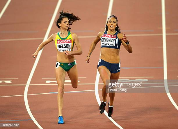 Ella Nelson of Australia and Ramona Papaioannou of Cyprus competes in the Women's 200 metres heats during day five of the 15th IAAF World Athletics...