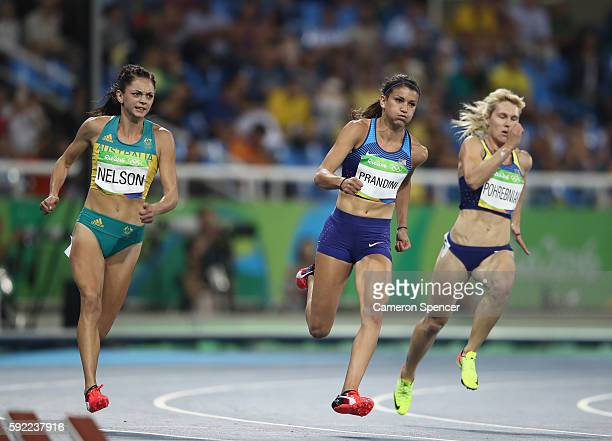 Ella Nelson of Australia Jenna Prandini of the United States and Natalia Pohrebniak of Ukraine compete in the Women's 200m semifinal on Day 11 of the...