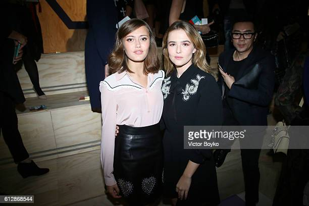 Ella Purnell and Zoey Deutch attend the Miu Miu show as part of the Paris Fashion Week Womenswear Spring/Summer 2017 on October 5 2016 in Paris France