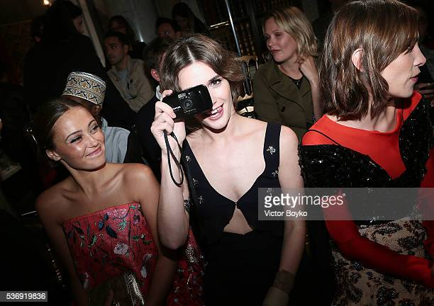 Ella Purnell Sai Bennett and Alex Chung attend the Dior Cruise Collection show 2017 at Blenheim Palace on May 31 2016 in Woodstock England