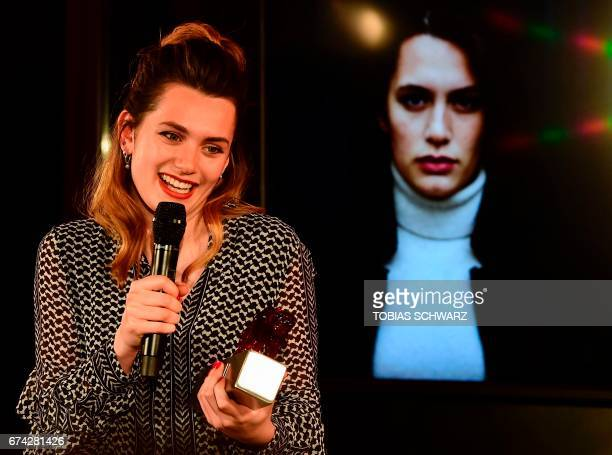 Ella Rumpf reacts after beeing honored as best actress during the New Faces award ceremony in Berlin on April 27 2017 / AFP PHOTO / TOBIAS SCHWARZ