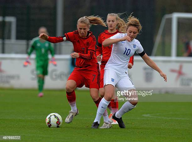 Ella Rutherford of England tackles Klara Buhl of Germany during Women's U16s International Friendly match between England U16s Women and Germany U16s...