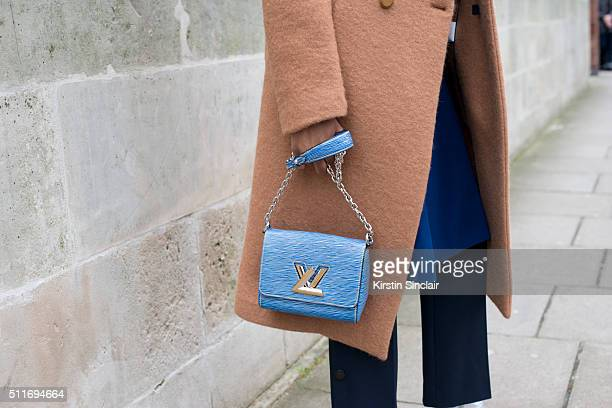 Elle accessories editor Donna Wallace wears a Joseph coat and Louis Vuitton bag on day 3 during London Fashion Week Autumn/Winter 2016/17 on February...