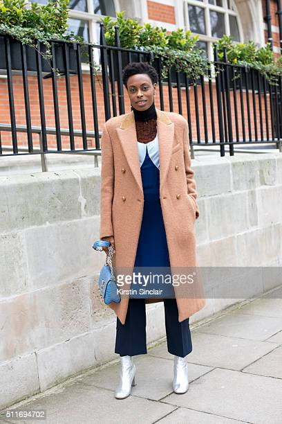 Elle accessories editor Donna Wallace wears a Joseph coat Louis Vuitton dress Claudie Pierlot trousers and Louis Vuitton bag on day 3 during London...