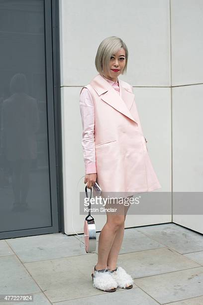 Elle China contributor Candy Li wears Away Lee jacket Carven shirt and Topshop shoes on day 3 of London Collections Men on June 14 2015 in London...