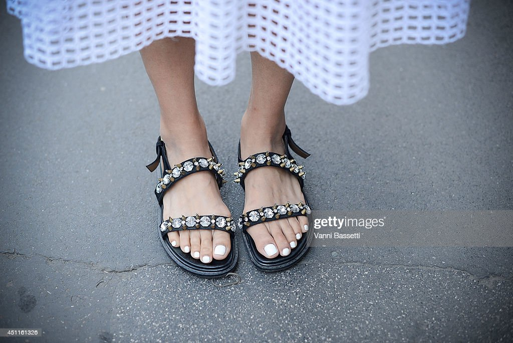 Elle China's Fashion editor Yoyo Lu poses in a Carven skirt and Marni sandals after Ermanno Scervino show on June 24 2014 in Milan Italy