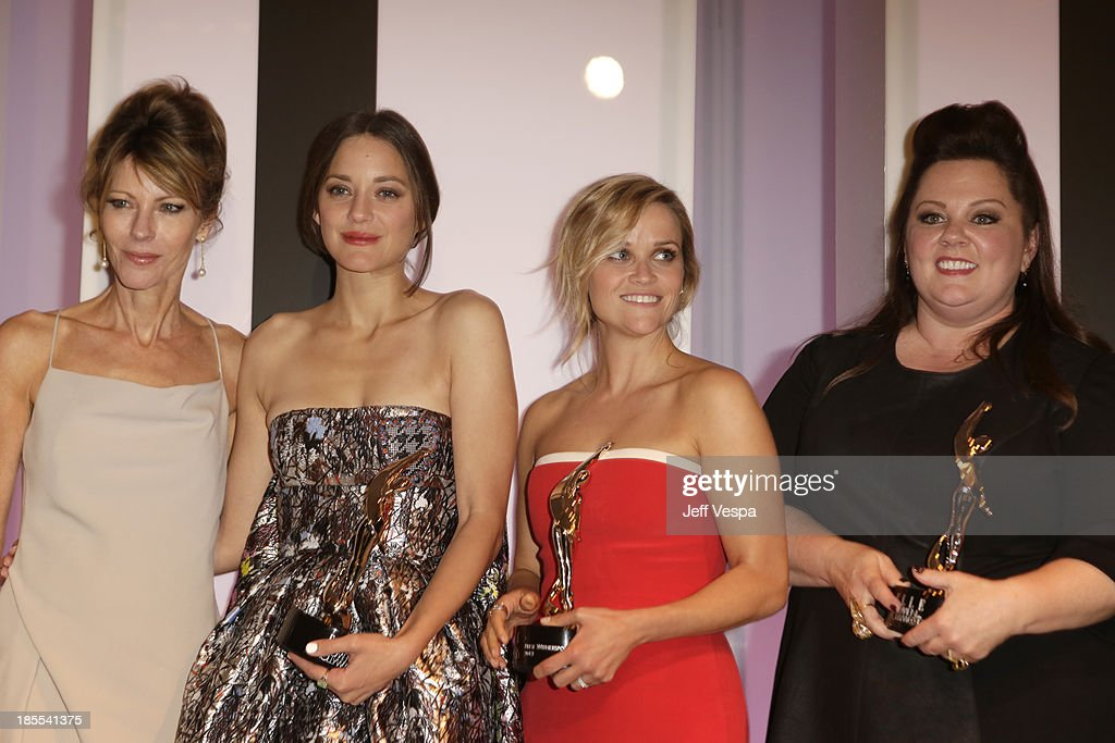 Elle Editor in Chief Robbie Myers and honorees Marion Cotillard, Reese Witherspoon and Melissa McCarthy pose with awards at ELLE's 20th Annual Women In Hollywood Celebration at Four Seasons Hotel Los Angeles at Beverly Hills on October 21, 2013 in Beverly Hills, California.