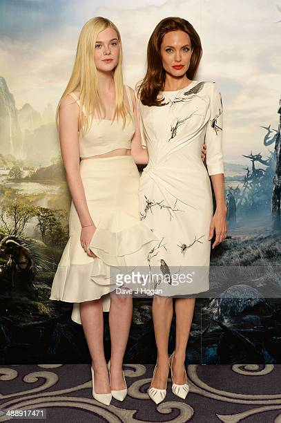 Elle Fanning and Angelina Jolie attend a photocall for 'Maleficent' at The Corinthia Hotel on May 9 2014 in London England