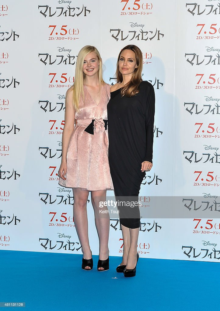 Elle Fanning (L) and Angelina Jolie attend 'Maleficent' press conference for the Japan premiere at Grand Hyatt Tokyo on June 24, 2014 in Tokyo, Japan.