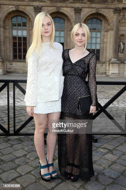 Elle Fanning and Dakota Fanning attend the Louis Vuitton show as part of the Paris Fashion Week Womenswear Spring/Summer 2014 on October 2 2013 in...