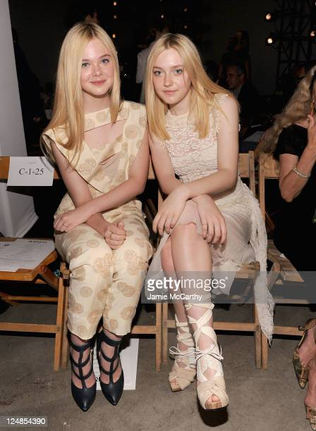 Elle Fanning and Dakota Fanning attend the Rodarte Spring 2012 fashion show during MercedesBenz Fashion Week at on September 13 2011 in New York City