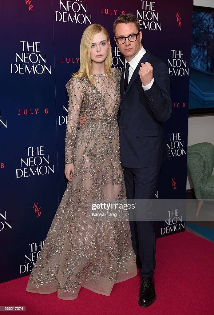 <a gi-track='captionPersonalityLinkClicked' href=/galleries/search?phrase=Elle+Fanning&family=editorial&specificpeople=2189940 ng-click='$event.stopPropagation()'>Elle Fanning</a> and director <a gi-track='captionPersonalityLinkClicked' href=/galleries/search?phrase=Nicolas+Winding+Refn&family=editorial&specificpeople=5498587 ng-click='$event.stopPropagation()'>Nicolas Winding Refn</a> arrive for the UK Premiere of The Neon Demon at the Picturehouse Central on May 31, 2016 in London, United Kingdom.