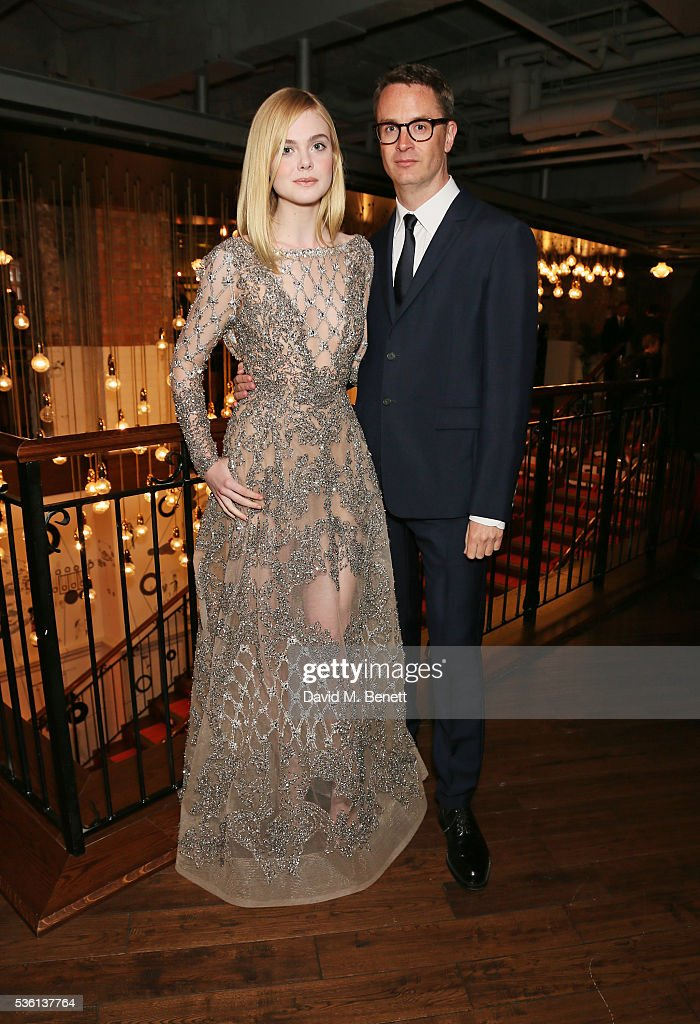 <a gi-track='captionPersonalityLinkClicked' href=/galleries/search?phrase=Elle+Fanning&family=editorial&specificpeople=2189940 ng-click='$event.stopPropagation()'>Elle Fanning</a> (L) and director <a gi-track='captionPersonalityLinkClicked' href=/galleries/search?phrase=Nicolas+Winding+Refn&family=editorial&specificpeople=5498587 ng-click='$event.stopPropagation()'>Nicolas Winding Refn</a> attend the UK Premiere of 'The Neon Demon' at Picturehouse Central on May 31, 2016 in London, England.