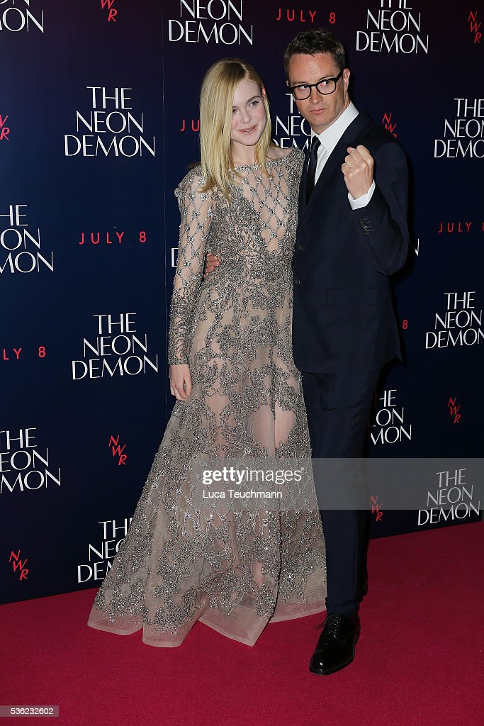 <a gi-track='captionPersonalityLinkClicked' href=/galleries/search?phrase=Elle+Fanning&family=editorial&specificpeople=2189940 ng-click='$event.stopPropagation()'>Elle Fanning</a> and <a gi-track='captionPersonalityLinkClicked' href=/galleries/search?phrase=Nicolas+Winding+Refn&family=editorial&specificpeople=5498587 ng-click='$event.stopPropagation()'>Nicolas Winding Refn</a> arrives for the UK Premiere of The Neon Demon on May 31, 2016 in London, United Kingdom.