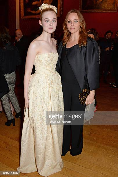 Elle Fanning and Stella McCartney attend a private reception as costumes and props from Disney's 'Maleficent' are exhibited in support of Great...
