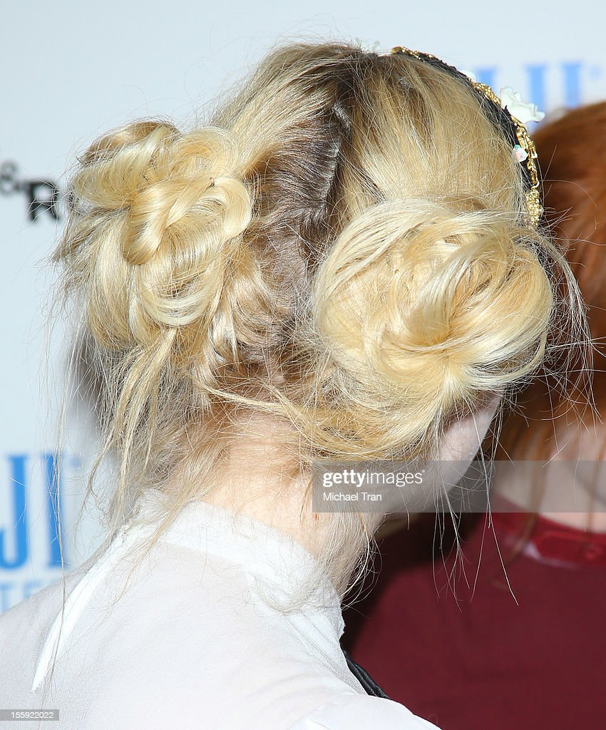 <a gi-track='captionPersonalityLinkClicked' href=/galleries/search?phrase=Elle+Fanning&family=editorial&specificpeople=2189940 ng-click='$event.stopPropagation()'>Elle Fanning</a> (hair detail) arrives at the Los Angeles special screening of 'Ginger & Rosa' held at The Paley Center for Media on November 8, 2012 in Beverly Hills, California.