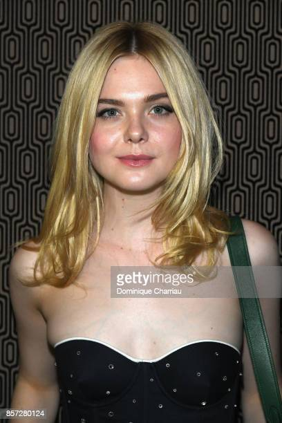 Elle Fanning attends the Miu Miu aftershow party as part of the Paris Fashion Week Womenswear Spring/Summer 2018 at Boum Boum on October 3 2017 in...