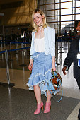 Elle Fanning is seen at LAX on February 13 2016 in Los Angeles California