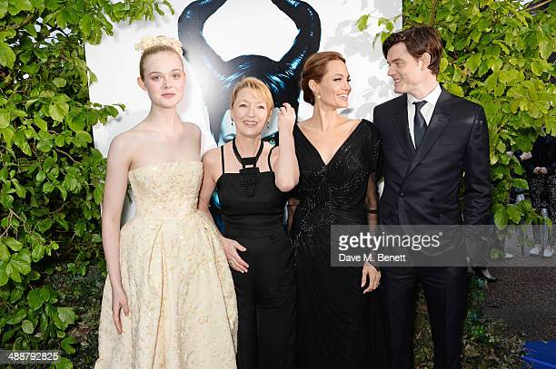 Elle Fanning Lesley Manville Angelina Jolie and Sam Riley arrive at a private reception as costumes and props from Disney's 'Maleficent' are...