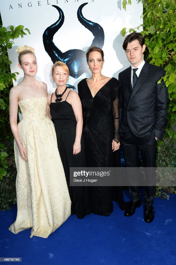 <a gi-track='captionPersonalityLinkClicked' href=/galleries/search?phrase=Elle+Fanning&family=editorial&specificpeople=2189940 ng-click='$event.stopPropagation()'>Elle Fanning</a>, <a gi-track='captionPersonalityLinkClicked' href=/galleries/search?phrase=Lesley+Manville&family=editorial&specificpeople=2826107 ng-click='$event.stopPropagation()'>Lesley Manville</a>, <a gi-track='captionPersonalityLinkClicked' href=/galleries/search?phrase=Angelina+Jolie&family=editorial&specificpeople=201591 ng-click='$event.stopPropagation()'>Angelina Jolie</a> and <a gi-track='captionPersonalityLinkClicked' href=/galleries/search?phrase=Sam+Riley+-+Actor&family=editorial&specificpeople=4693289 ng-click='$event.stopPropagation()'>Sam Riley</a> attend the 'Maleficent' Costume And Props Private Reception at Kensington Palace on May 8, 2014 in London, England.