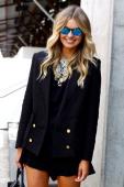 Elle Ferguson wears a blazer by Camilla Marc necklace by Dylan X and shorts by One Teaspoon at MercedesBenz Fashion Week Australia Spring/Summer...