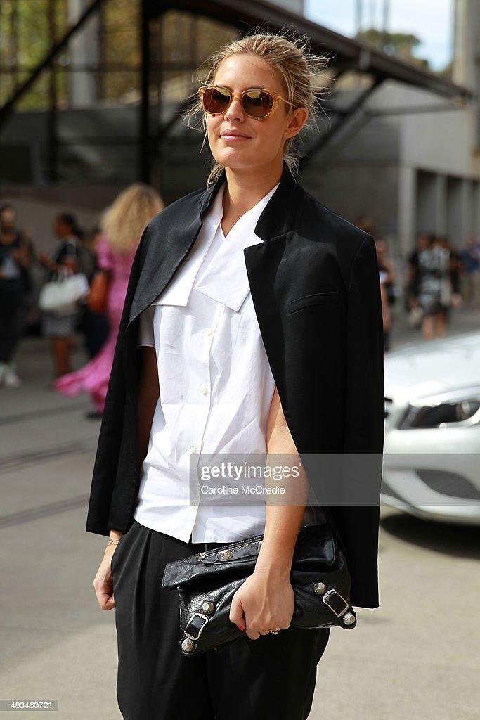 Elle Halliwell wearing Alexander Wang shirt, Mode Collective shoes, Goot pants, Armani sunglasses and Balenciaga handbag at Mercedes-Benz Fashion Week Australia 2014 at Carriageworks on April 9, 2014 in Sydney, Australia.