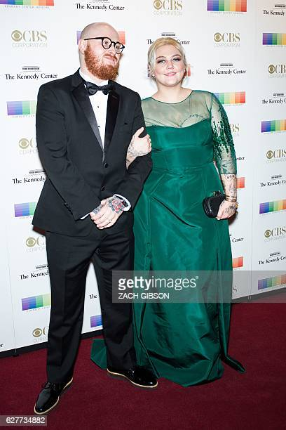 Elle King poses on the red carpet with her fiance Andrew Ferguson before the 39th Annual Kennedy Center Honors December 4 2019 in Washington DC / AFP...