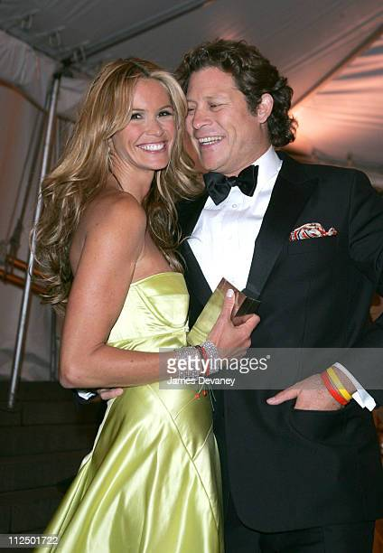 Elle Macpherson and Arpad Busson during 'Chanel' Costume Institute Gala at The Metropolitan Museum of Art Departures at The Metropolitan Museum of...