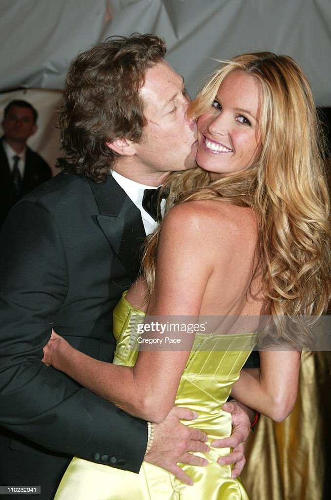 Elle Macpherson and Arpad Busson during The Costume Institute's Gala Celebrating 'Chanel' - Departures at The Metropolitan Museum of Art in New York City, New York, United States.