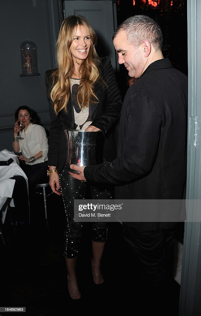USE. <a gi-track='captionPersonalityLinkClicked' href=/galleries/search?phrase=Elle+Macpherson&family=editorial&specificpeople=202490 ng-click='$event.stopPropagation()'>Elle Macpherson</a> and Barry the Dog Jogger attend The Right To Play host a private dinner for Barry the Dog fitness trainer ahead of his husky expedition across the Arctic at 3 Cromwell Road on March 26, 2013 in London, England.