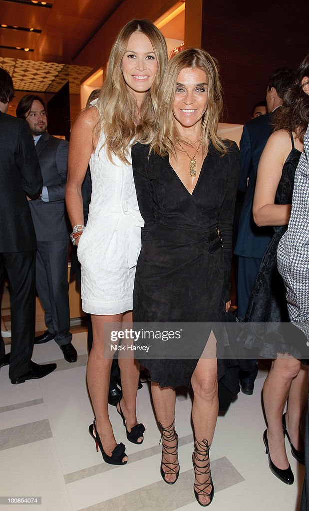 Elle Macpherson (L) and Carine Roitfeld attend the launch of the Louis Vuitton Bond Street Maison on May 25, 2010 in London, England.