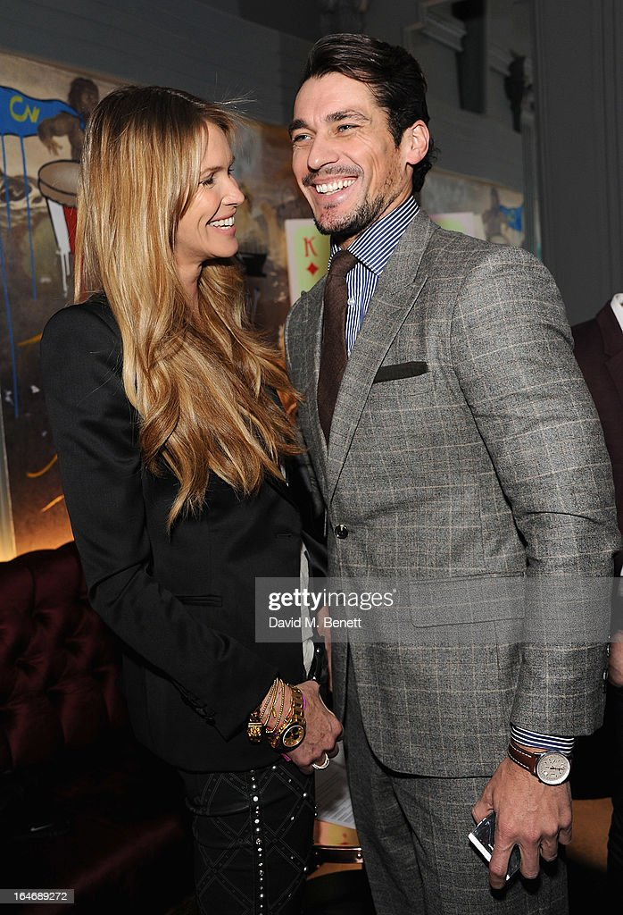 USE. <a gi-track='captionPersonalityLinkClicked' href=/galleries/search?phrase=Elle+Macpherson&family=editorial&specificpeople=202490 ng-click='$event.stopPropagation()'>Elle Macpherson</a> and <a gi-track='captionPersonalityLinkClicked' href=/galleries/search?phrase=David+Gandy&family=editorial&specificpeople=4377663 ng-click='$event.stopPropagation()'>David Gandy</a> attends The Right To Play host a private dinner for Barry the Dog fitness trainer ahead of his husky expedition across the Arctic at 3 Cromwell Road on March 26, 2013 in London, England.