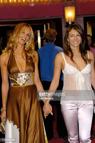Elle MacPherson and Elizabeth Hurley during 'Mary Poppins' Gala Evening Inside Arrivals at Old Compton Street in London Great Britain