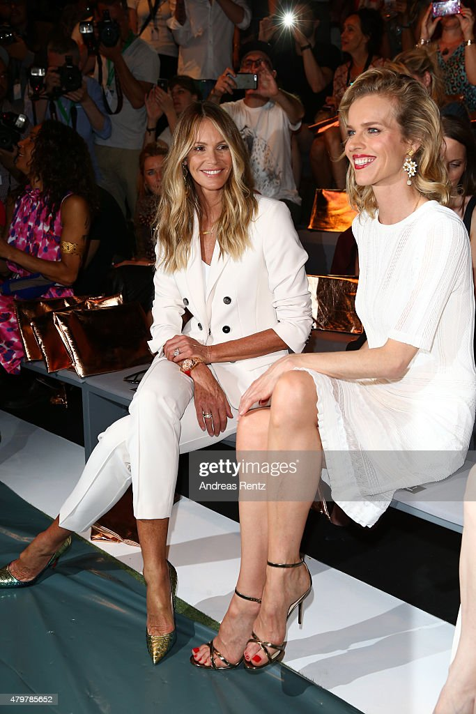 Elle Macpherson and Eva Herzigova attend the Marc Cain show during the Mercedes-Benz Fashion Week Berlin Spring/Summer 2016 at Brandenburg Gate on July 7, 2015 in Berlin, Germany.