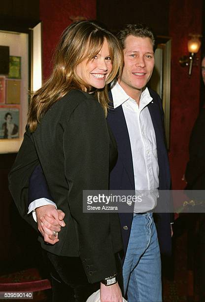 Elle Mc Pherson and her friend Arpad Busson arrive at the Ziegfeld Theater