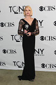 Ellen Barkin poses with the award for Best Performance by an Actress in a Featured Role in a Play during the 65th Annual Tony Awards at the The...
