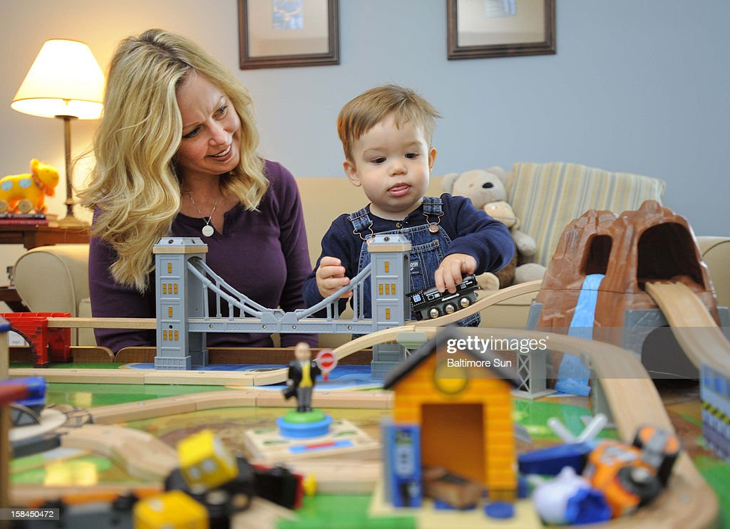 Ellen Carpenter, left, and her toddler son Zachary, who was conceived using frozen donated eggs, have some play time, December 5, 2012, in Points of Rocks, Maryland.