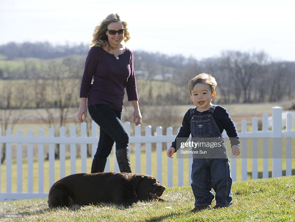 Ellen Carpenter, left, and her toddler son Zachary, who was conceived using frozen donated eggs, play in their yard with their dog, Sampson, December 5, 2012, in Points of Rocks, Maryland.