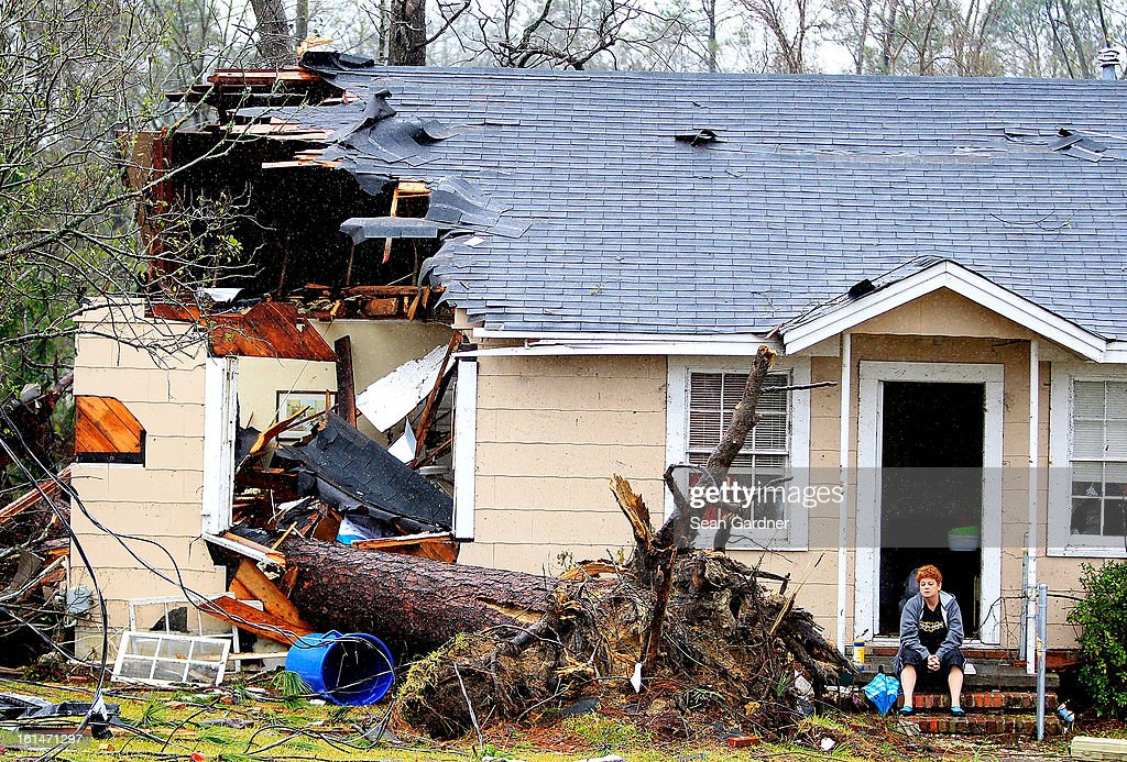 Ellen Chmiel sits on the steps of her home a day after a tornado touched down on February 11, 2013 in Hattiesburg, Mississippi. Hundreds of homes were destroyed and over sixty people injured when the tornado ripped through the town.