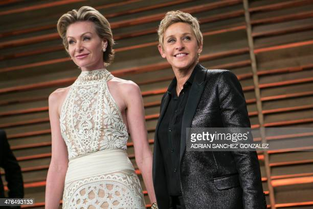 Ellen DeGeneres and Portia de Rossi arrive to the 2014 Vanity Fair Oscar Party on March 2 2014 in West Hollywood California AFP PHOTO/ADRIAN...