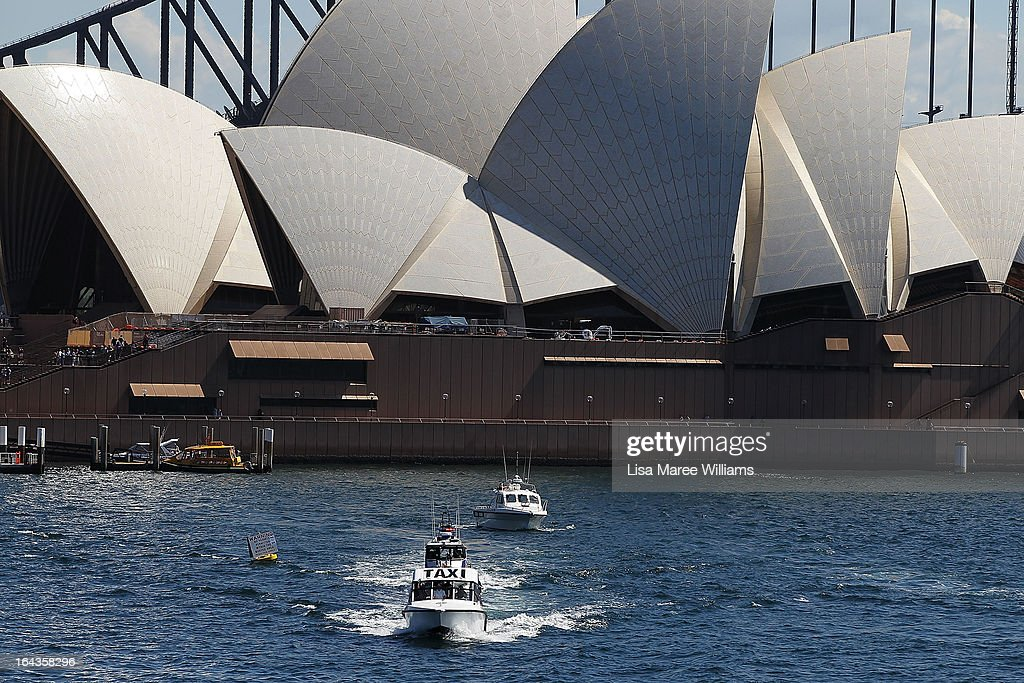 Ellen DeGeneres and Portia di Rossi travel via water taxi to the filming of Ellen's television show on a floating stage above Sydney Harbour on March 23, 2013 in Sydney, Australia. DeGeneres is in Australia to film segments for her TV show, 'Ellen'