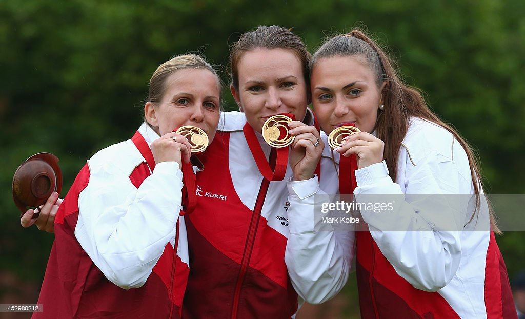 Ellen Falkner, Sian Gordon and Sophie Tolchard of England pose with their gold medals as they celebrate victory in the women's triples final match between England and Australia at Kelvingrove Lawn Bowls Centre during day eight of the Glasgow 2014 Commonwealth Games on July 31, 2014 in Glasgow, United Kingdom.