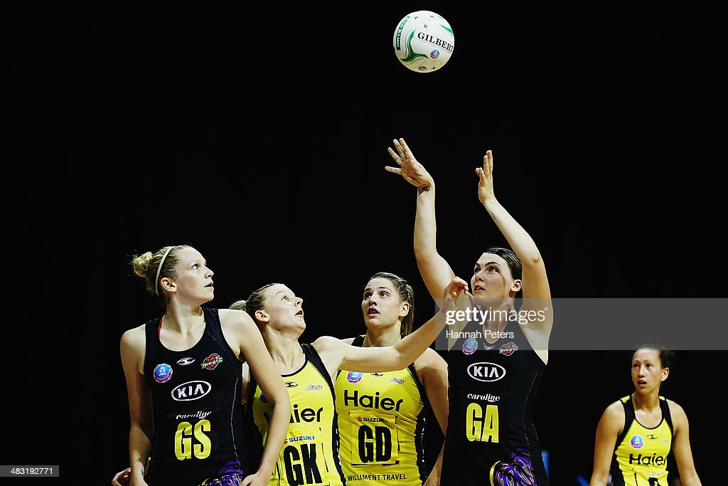 Ellen Halpenny of the Magic shoots during the ANZ Championship match between the Magic and the Pulse on April 7, 2014 in Auckland, New Zealand.